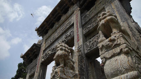 China stone arch building & ancient city gate.movement of clouds,stone lions Live Action