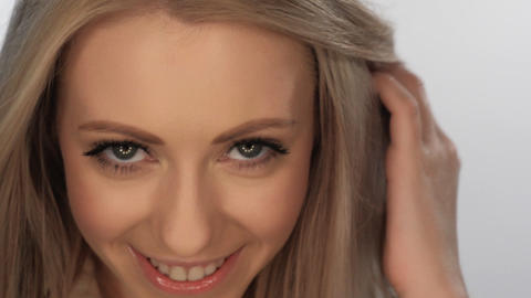 beautiful blonde girl smiling playfully Footage