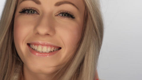 beautiful blonde girl smiling playfully Stock Video Footage
