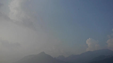 Clouds on top of hill & mountain.Many dragonflies Stock Video Footage