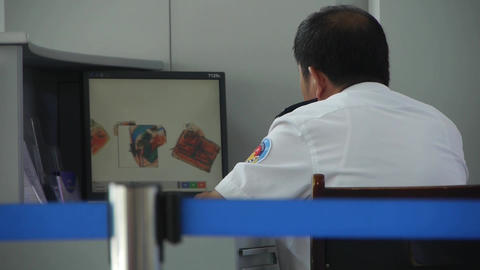 Men using electronic scanner to check items at airport... Stock Video Footage