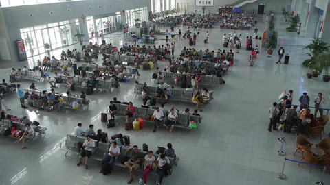 Many people in busy waiting hall.entrance to airport... Stock Video Footage