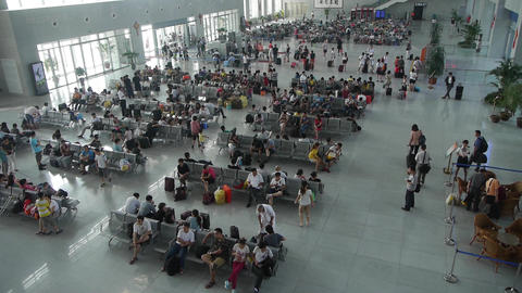 Many people in busy waiting hall.entrance to airport & railway station.timel Footage