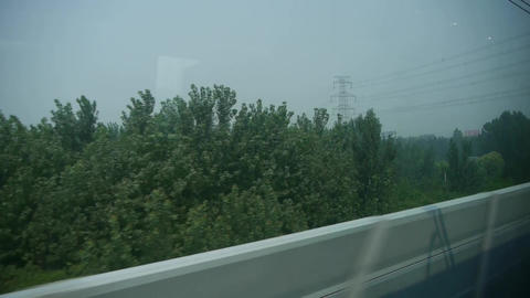 Speeding train travel,scenery outside window.Villages plains tree & Guardrai Footage