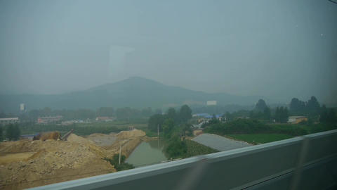 Speeding train travel,scenery outside window.Villages... Stock Video Footage