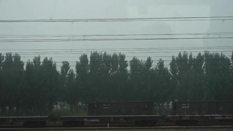 Speeding train travel,scenery outside window.Villages... Stock Video Footage