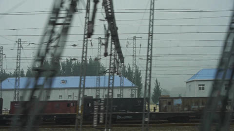 Speeding train travel,scenery outside window.Villages plains tree farmland.high- Footage