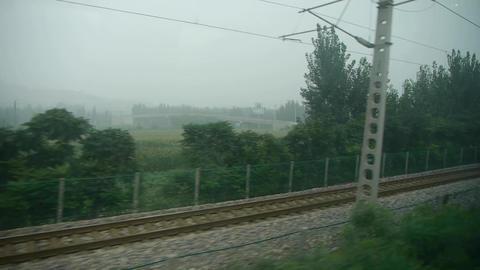 Speeding train travel,scenery outside window.Villages plains tree farmland.overp Footage