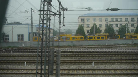 Speeding train travel,scenery outside window.train-station Stock Video Footage