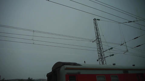 Speeding train travel,scenery outside window.train-station locomotives.high volt Live Action
