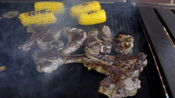 Mutton Chops and Corn Cooking on a Barbecue Stock Video Footage