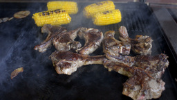 Mutton Chops and Corn Cooking on a Barbecue Footage