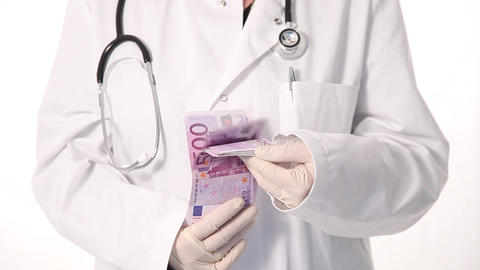 Doctor Playing With Lots Of Cash stock footage