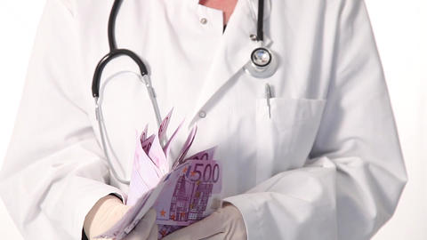 Doctor Counting Cash Money stock footage