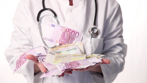Slomotion Doctor catching money Stock Video Footage