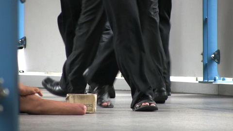 Business Men Pass Amputee On Sidewalk Stock Video Footage
