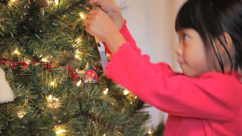 Asian Girl Hanging A Christmas Ornament Stock Video Footage