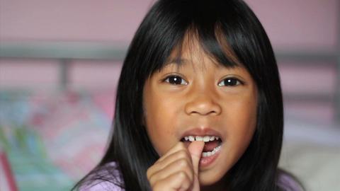 Asian Girl Wiggling Her First Loose Tooth Stock Video Footage