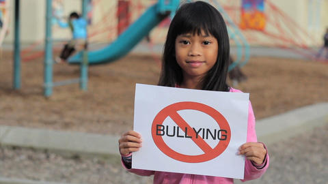 Cute Asian Girl With Large NO BULLYING sign Stock Video Footage