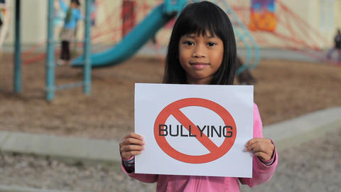 Cute Asian Girl With Large NO BULLYING sign Footage