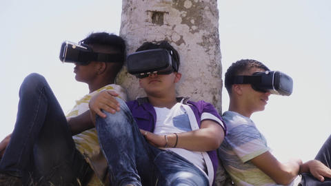 15-Multiethnic Group Of Teenagers Playing Virtual Reality Outdoor Footage