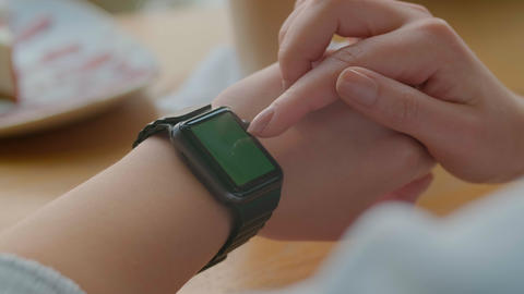 Woman using his smartwatch app. Woman using trendy smart watches mobile Live Action