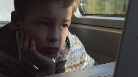 A boy in a train Archivo