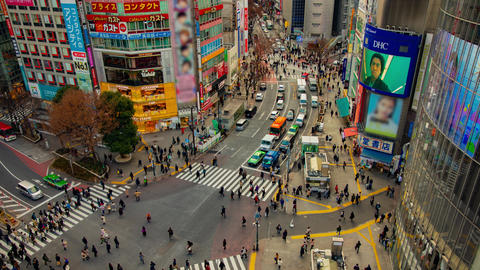 A timelapse of the famous crossing in Shibuya Tokyo high angle wide shot daytime Footage