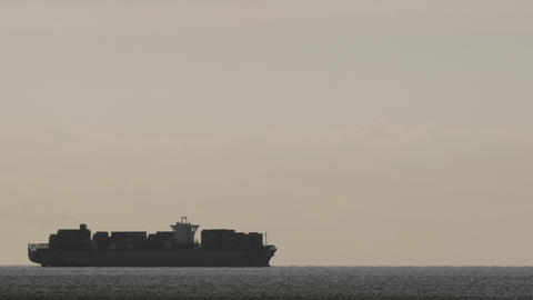 A cargo ship at dawn GIF