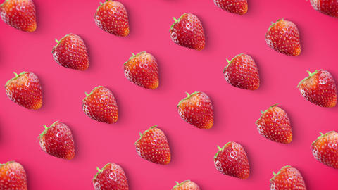 Strawberry rotating on pink background looped Animation
