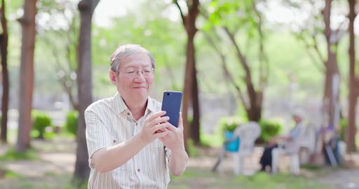 Older man selfie by cellphone Live Action