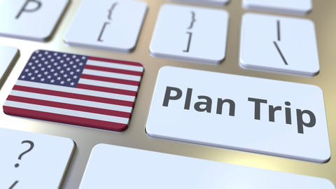 PLAN TRIP text and flag of the United States on the computer keyboard, travel Footage