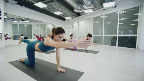 Yoga Practice Exercise Class Concept. Trainer shows exercises Live Action