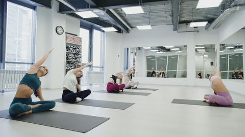 Yoga Practice Exercise Class Concept. Trainer shows exercises Footage