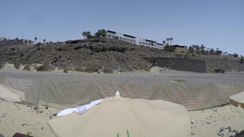 Seaside sandy beach and Seaside resort 360 degree timelapse in Fuerteventura Footage