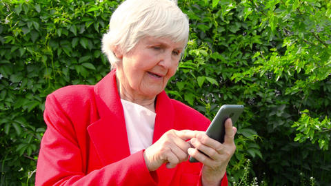 portrait of old lady, grandmother use phone outdoors at... Stock Video Footage