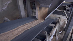 Sand is delivered by conveyor. Sand on the conveyor Footage
