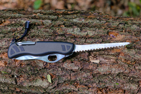 Multitool outdoor equipment, Swiss Soldier's Knife with extended saw blade on Photo