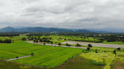 Drone shot aerial view scenic landscape of agriculture farm at countryside Footage