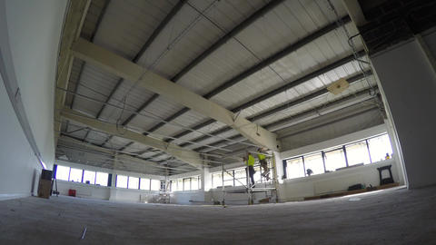 Construction, installation of suspended grid ceiling timelapse 4K Live Action