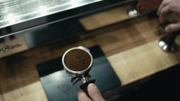 Barista is Making Coffee using Machine. Man is Shaking and Pressing Coffee Archivo