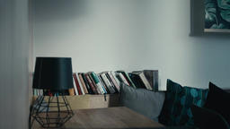 Interior: Table, Lamp, Books on a Bookshelf and Pillows... Stock Video Footage