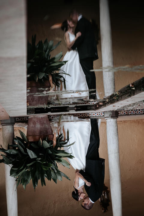 Wedding couple reflected in the water. Upside down image Photo
