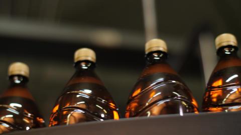 Plastic bottles on conveyor belt Live Action