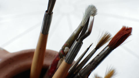 Close Up Of A Paint Brush and Clay Sculpting Art Tools Footage