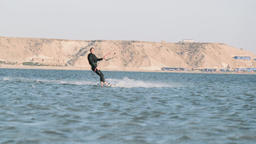Handsome Man Kitesurfing in Dakhla, Morocco Live Action