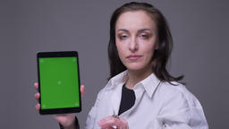 Closeup portrait of adult attractive caucasian female using the tablet and Footage