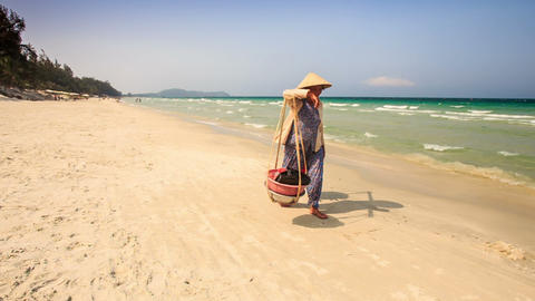 Vietnamese Woman Carries Food against Azure Sea Footage
