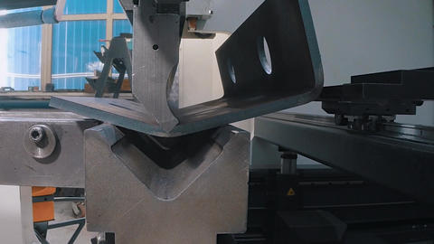A special machine performs the operation of bending the metal GIF