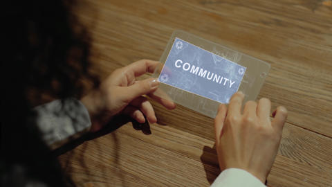 Hands hold tablet with text Community Footage